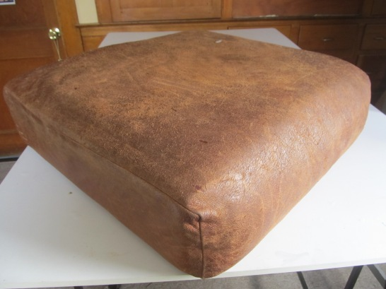 Before, leather couch cushion.