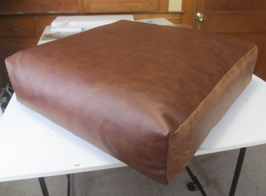 After, leather couch cushion. New top panel.